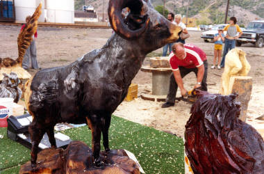 item thumbnail for Jerry Beebe, chainsaw artist at work. Old Miner's Day Parade. Kellogg, Idaho.
