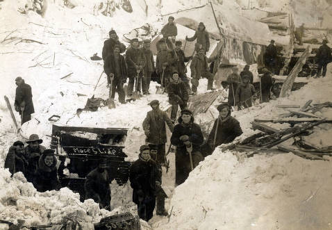 item thumbnail for Men digging buildings out of snow from snowslide. Mace, Idaho.