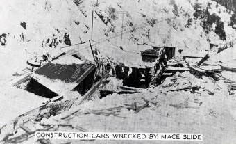 item thumbnail for Construction cars wrecked by snowslide. Mace, Idaho.