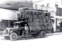 item thumbnail for Loaded truck of hay parked on street in front of a caf. Orofino, Idaho.