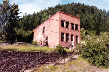 item thumbnail for One of few remaining buildings on north end of Old Burke. Building is east of destroyed fire hall.