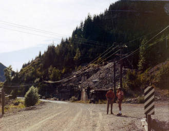 item thumbnail for Bill Etherton and Dave Osterberg standing along road in the canyon. Upper Burke Canyon. Idaho.
