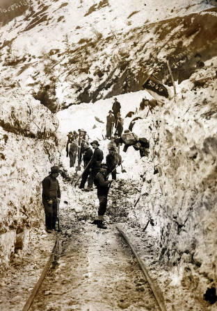item thumbnail for Men digging out railroad tracks after the snowslide. Mace, Idaho.