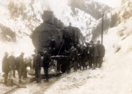 item thumbnail for Group in front of train engine after the snowslide. Mace, Idaho.