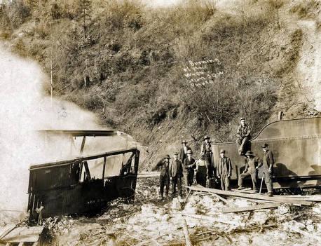 item thumbnail for Boxcar burning after train wreck. Mace, Idaho.