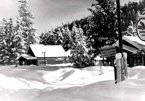 item thumbnail for Winter scene. View of a home and portion of a building with sign 'Sportsman's Club, Beer, Pop, Coffee, Lunches.'