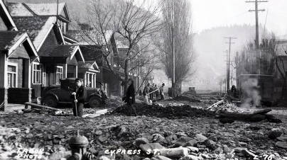 item thumbnail for Cleaning up the destruction on Cypress Street from the Placer Creek Flood. Wallace, Idaho.