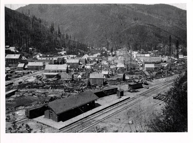 item thumbnail for View of Wallace, Idaho with the Oregon Railroad and Navigation Company Depot and tracks in the foreground.