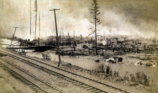 item thumbnail for Looking southeast from Northern Pacific Depot at part of Wallace, Idaho burnt from the fire.