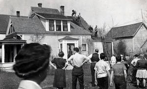 item thumbnail for Firemen on the roof of a house. Group of people watching. Wallace, Idaho.