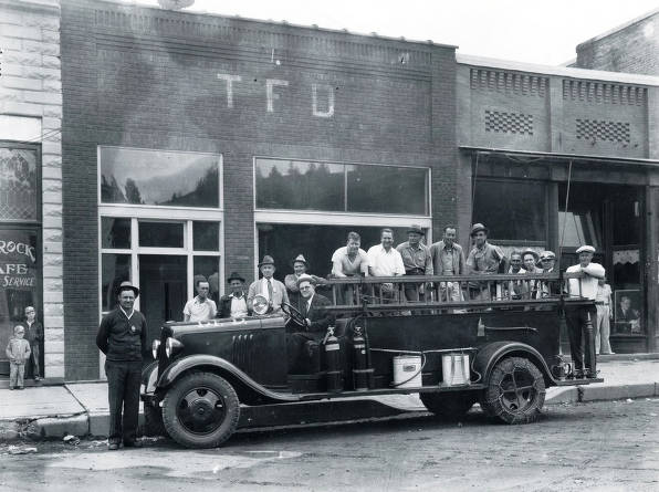 item thumbnail for Group of men on fire truck in front of Troy Fire Department. Troy, Idaho.