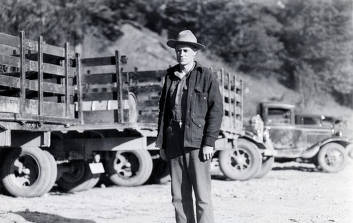 item thumbnail for Man standing by vehicles. CCC camp-Camp Harry Marsh, F-30, Co. 967. Prichard, Idaho.