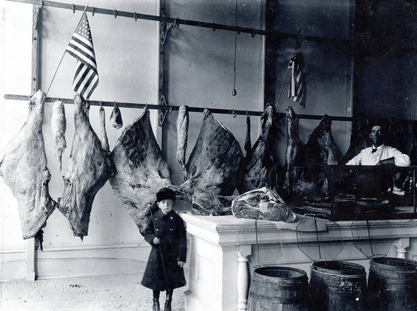 item thumbnail for Interior of butcher shop showing Alfred and Art Flint. Range Market. Troy, Idaho.