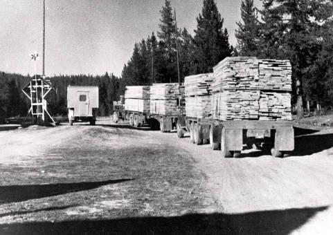item thumbnail for Loaded lumber trucks going through Dixie, Idaho.
