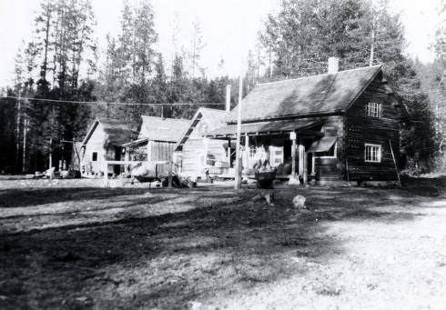 item thumbnail for Dixie Ranger Station crew. L-R: new ranger dwelling under construction, old dwelling, winter-proof storage cellar, office and commissary