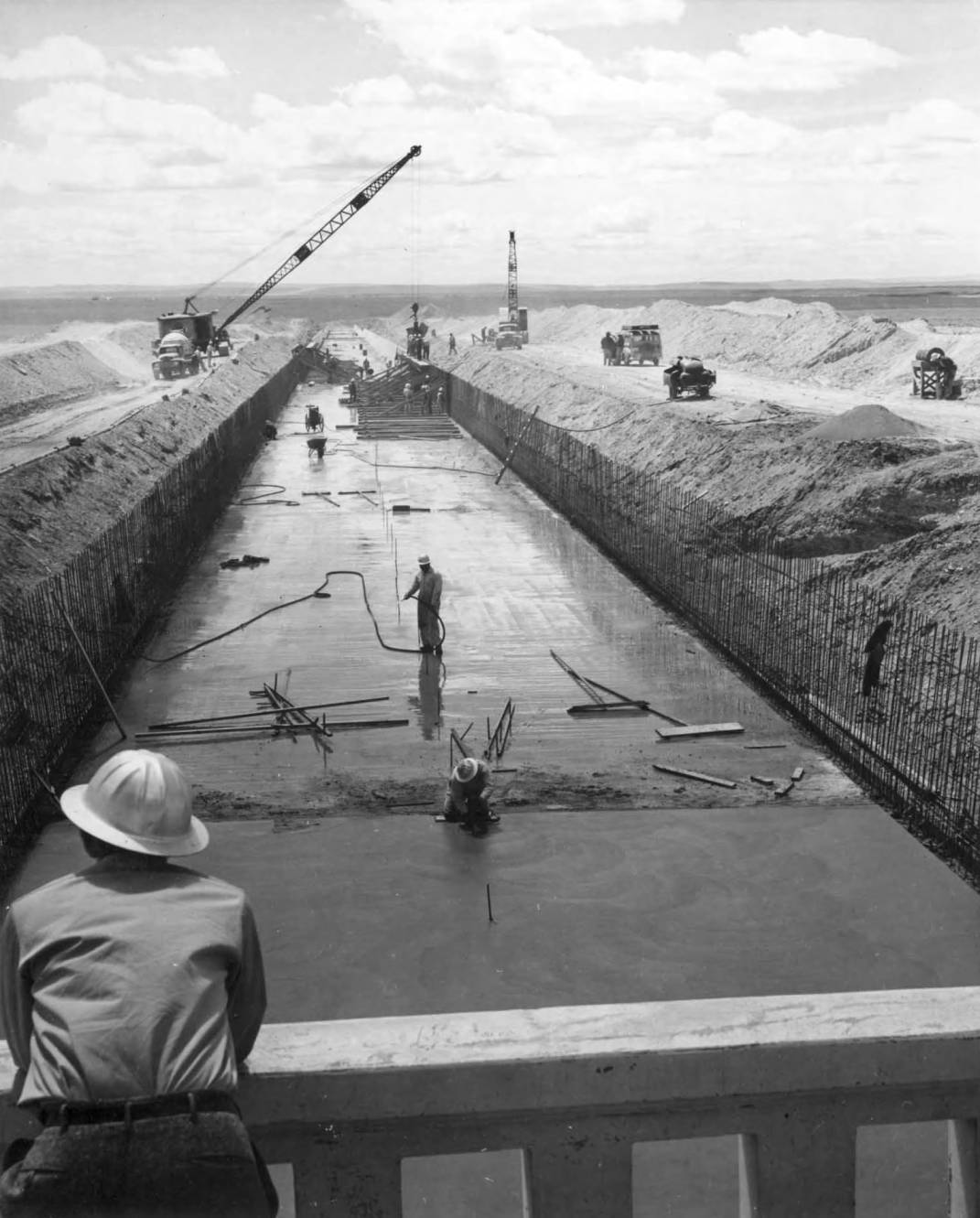 item thumbnail for A View Of Work Being Performed On Fresh Concrete At Winchester Wasteway (Canal lining and construction)