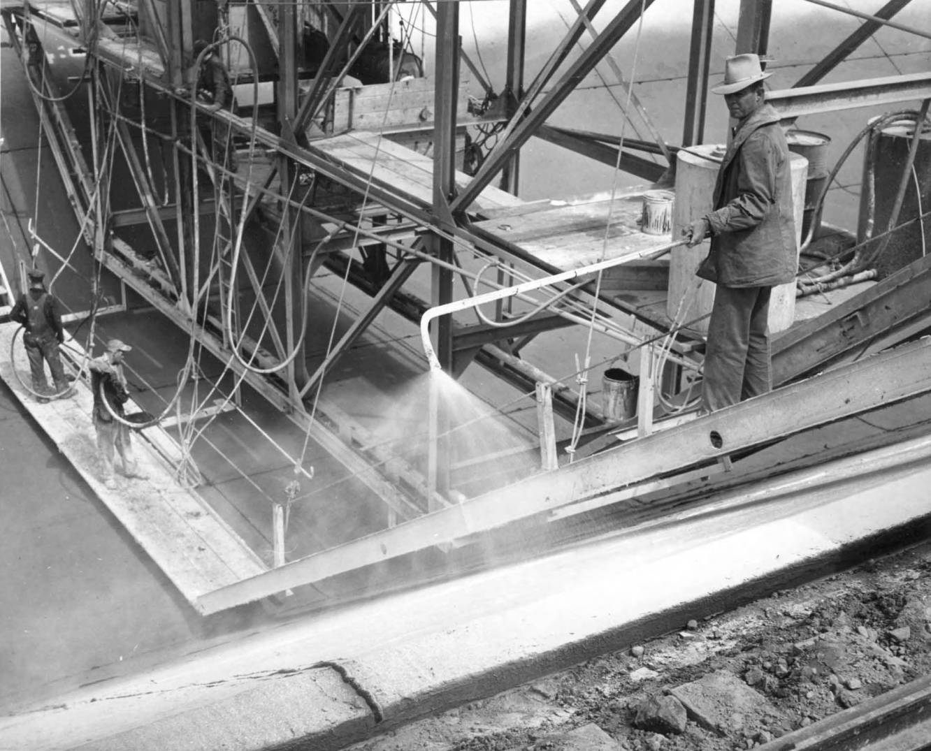 item thumbnail for Men Apply Curing Compounds To The Canal (Canal lining and construction)