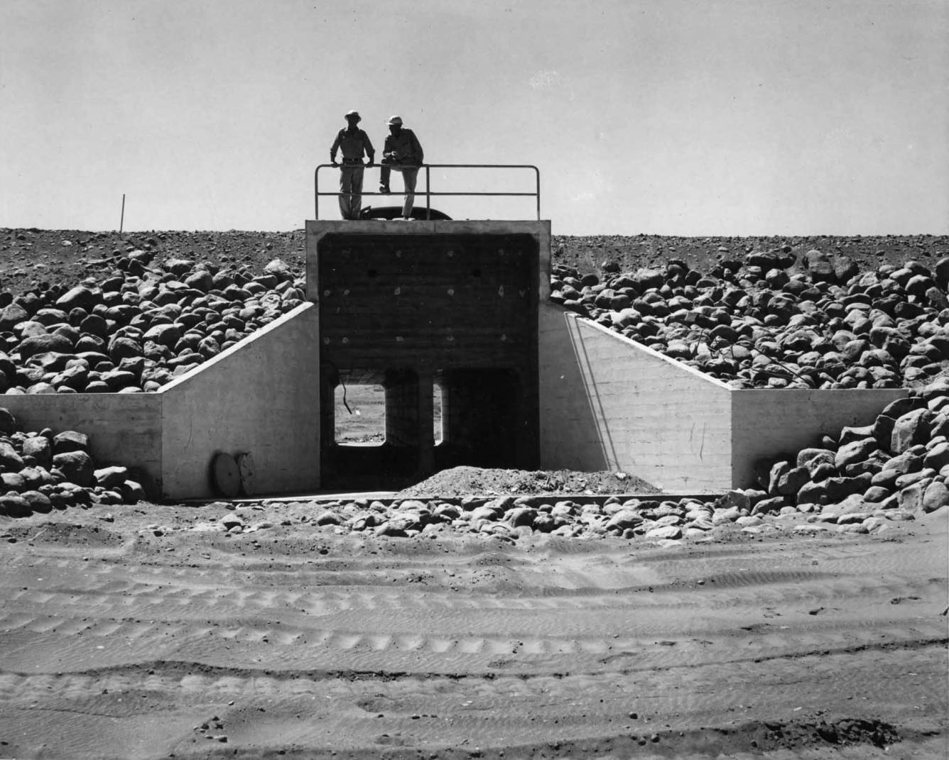 item thumbnail for Two Men Inspect Culverts (Canal lining and construction)