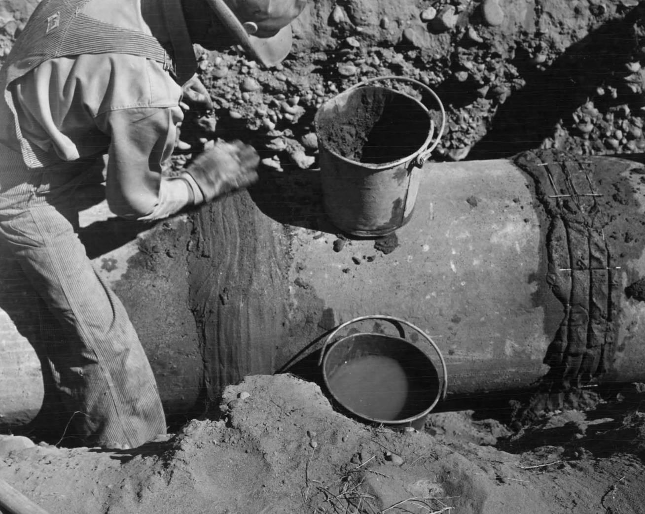 item thumbnail for Man Lays 21 Inch Irrigation Pipe (Farm development)