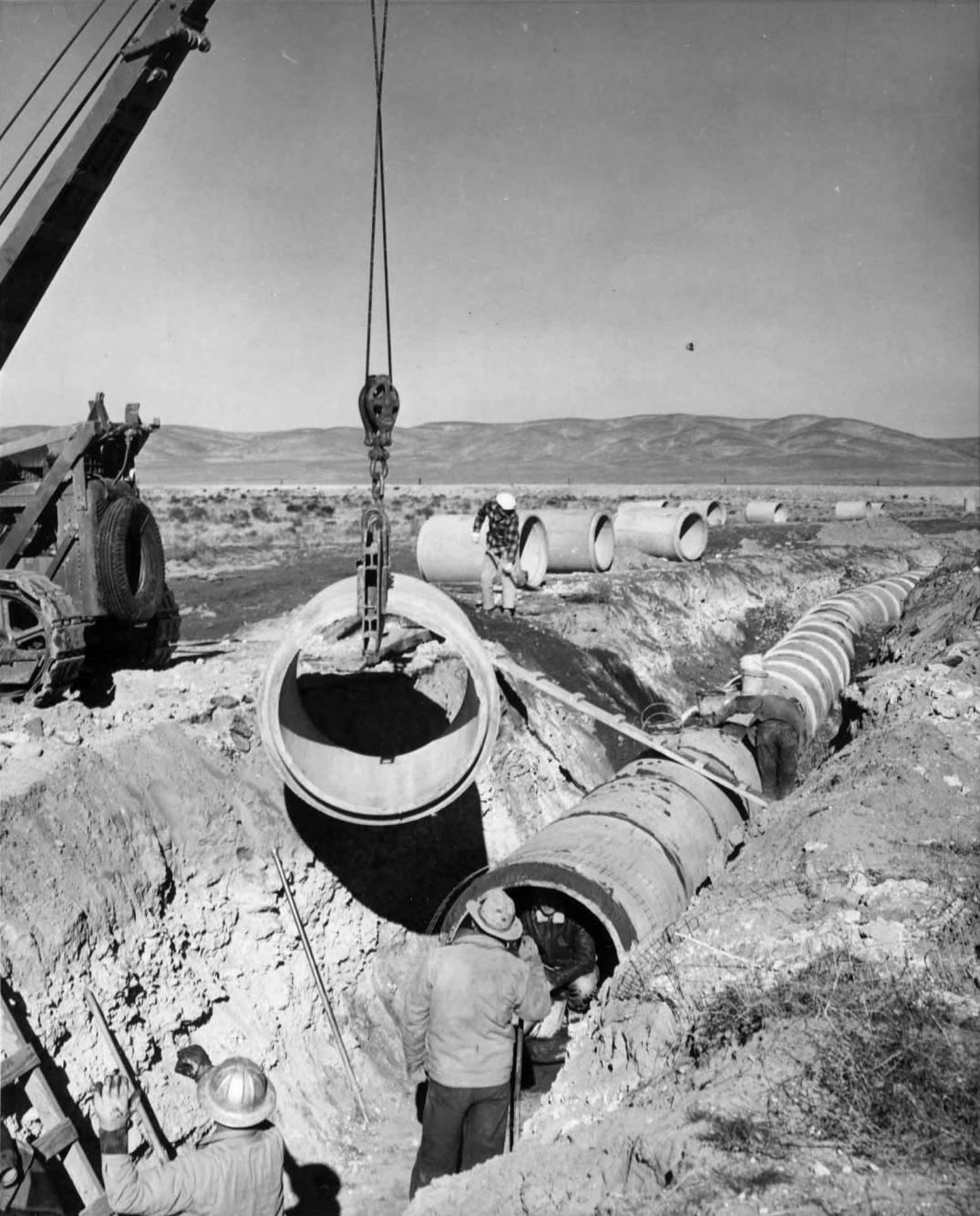 item thumbnail for Workman Installing 42'Pipe [02] (Farm development)