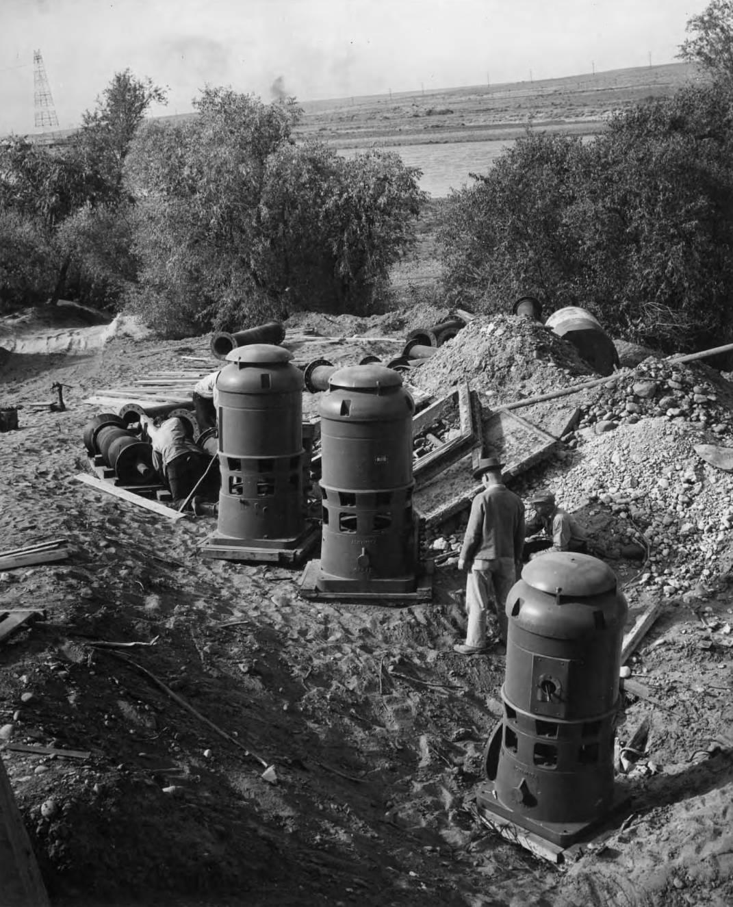item thumbnail for Men Prepare Pumps For Installation (Farm development)