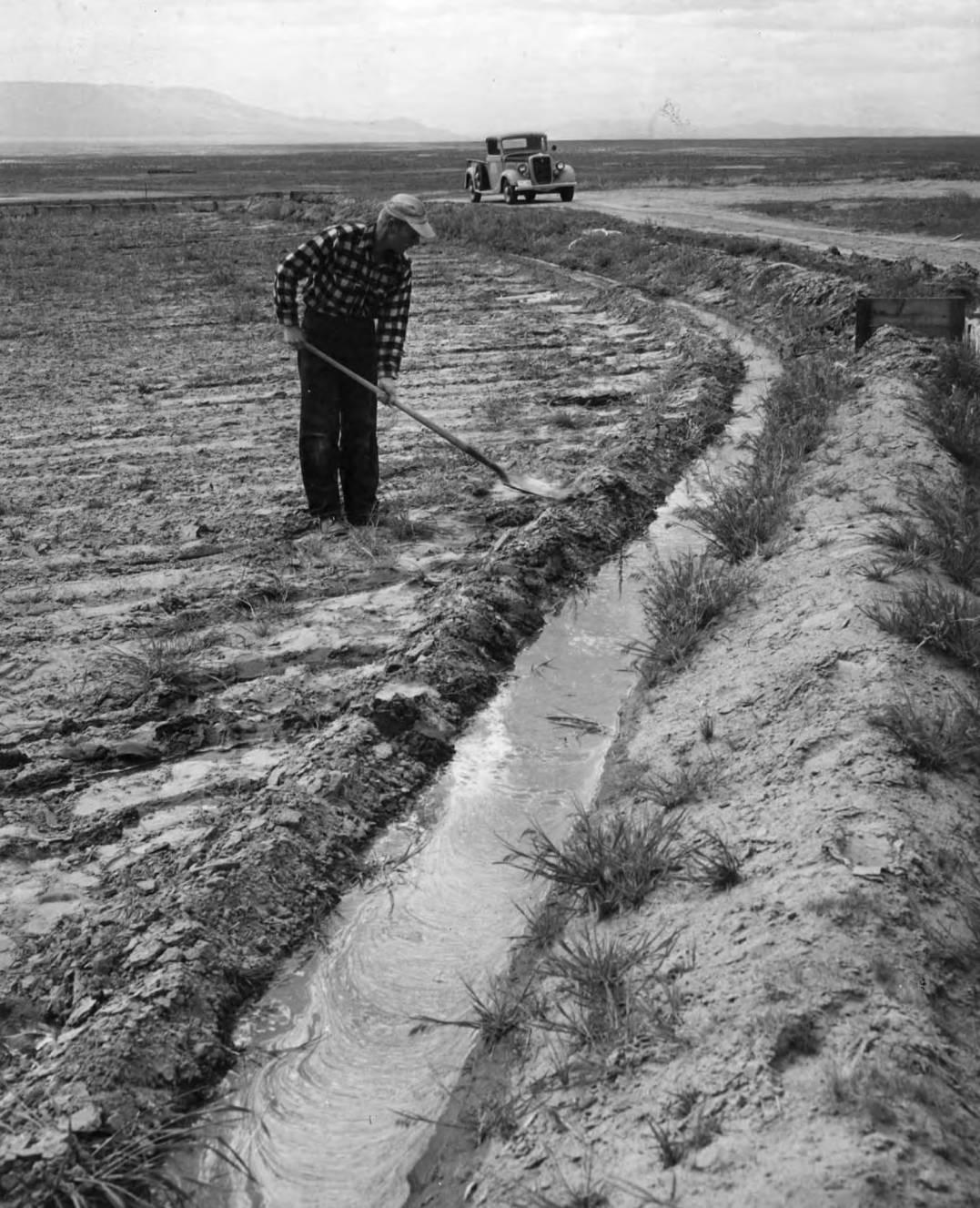 item thumbnail for Farmer Works A Ditch Around His Field (Farm development)
