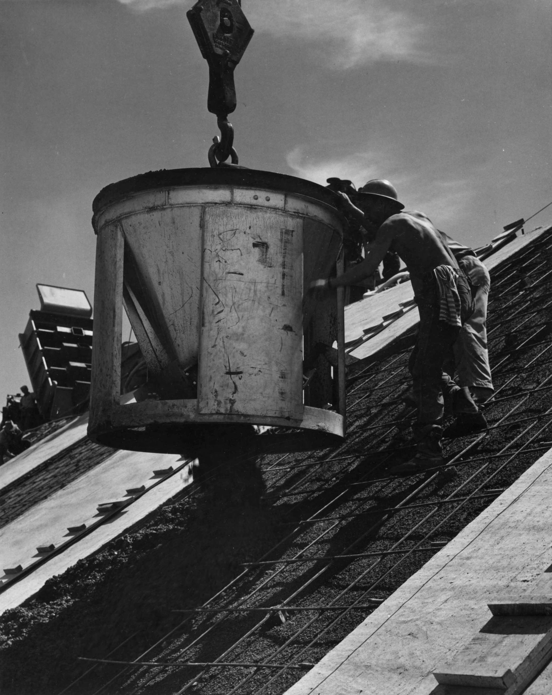item thumbnail for Man Negotiates Concrete Bucket (Canal lining and construction)