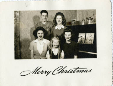 Image of Packard children in front of piano as Christmas Card
