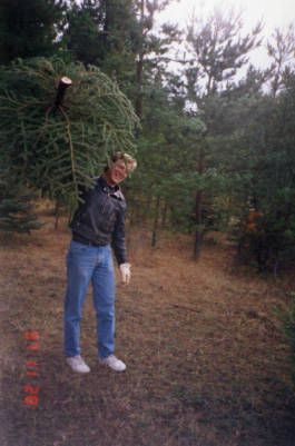Image of Lawrence Daniels holding fresh cut tree