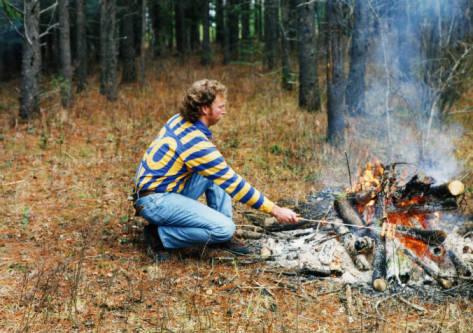 Image of Kelvin Daniels in front of fire