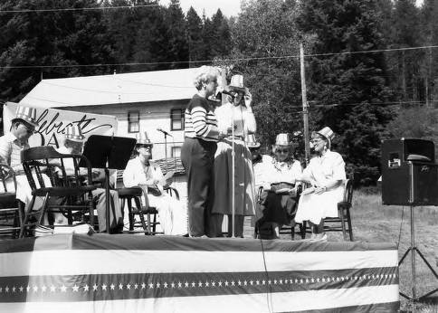 item thumbnail for Women Speaking on stage during Statehood Day