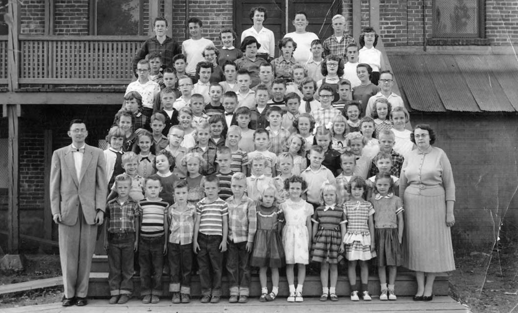 1957 class of Bovill Grade School Students Standing Outside