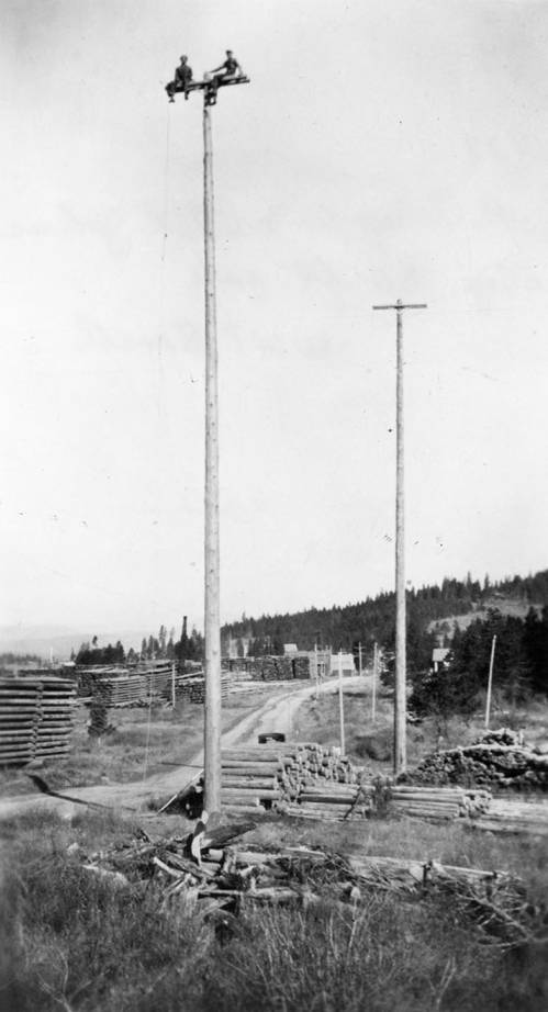 H. Schupfer and Phil Johns Raise Electric Utility Poles