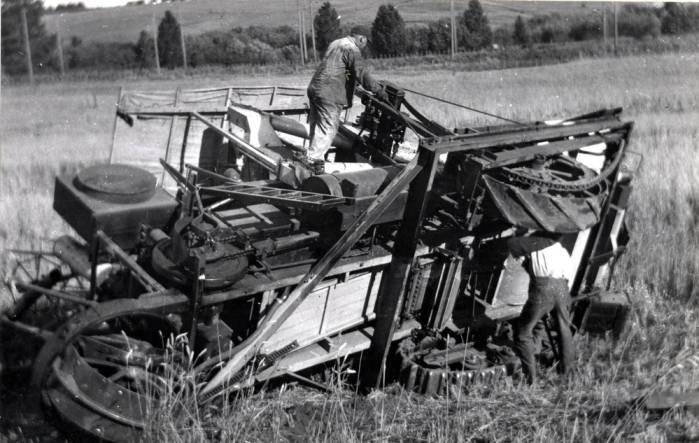 item thumbnail for Holt self-propelled combine, turned on side