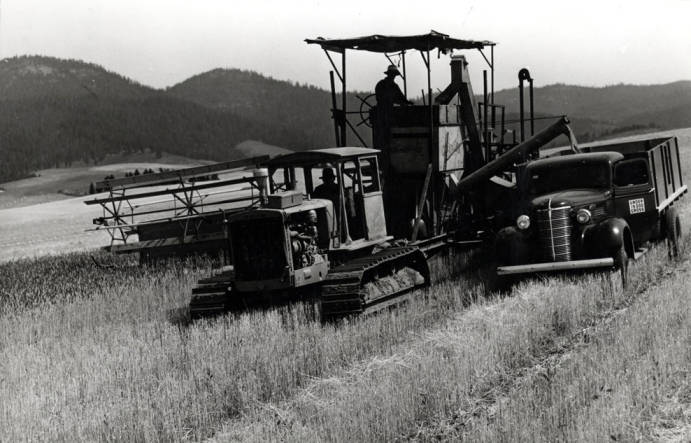 item thumbnail for Lundquist combine outfit stopping to offload wheat into truck