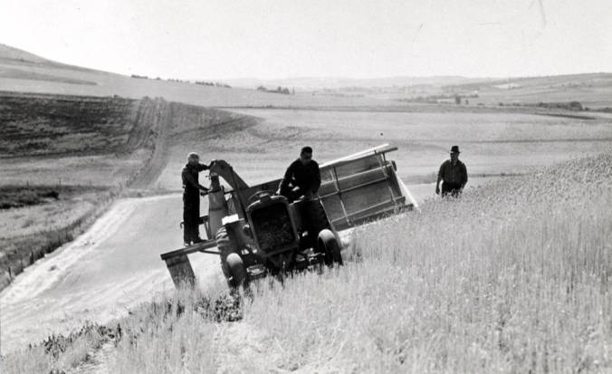 item thumbnail for Combine harvesting wheat pulled by a four-wheel tractor