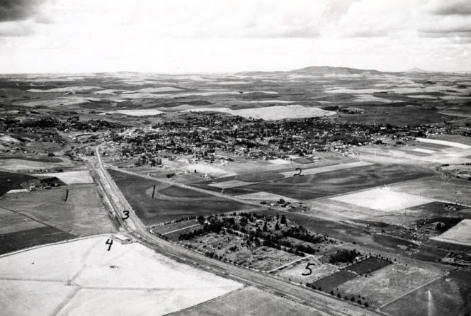 item thumbnail for Aerial of Moscow showing Skattaboe farm, Northern Pacific railroad, and Moscow Cemetery