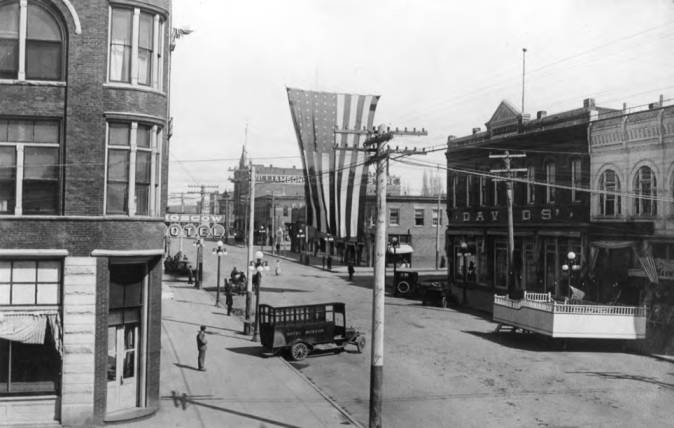 item thumbnail for Looking north at Main Street from Fourth Street in the 1920s, with Hotel Moscow bus