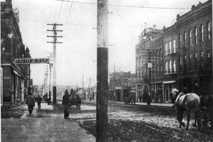 item thumbnail for Looking south at the west side of Main Street from north side of Third Street in the foreground