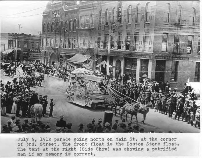 item thumbnail for July 4, 1912 parade going north on Main Street at the corner of Third Street