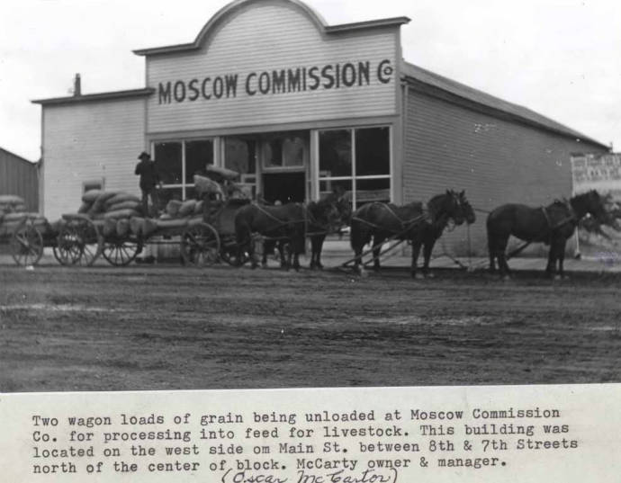 item thumbnail for Two wagon loads of grain being unloaded at Moscow Commission Company