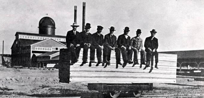item thumbnail for Men sitting on lumber atop railroad car near Potlatch