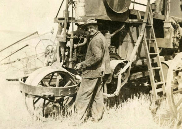 item thumbnail for Robert W. McKown with his self-propelling combine