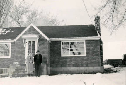 item thumbnail for Roy and Emma Davis in front of home