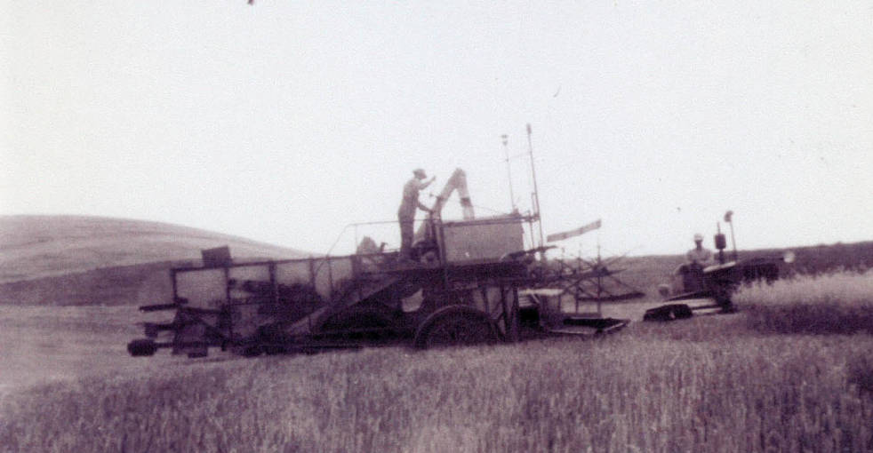 item thumbnail for Threshing grain with tractor