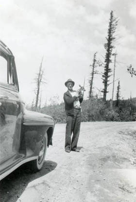 item thumbnail for Roy Davis holding a fawn on Mt. Spokane
