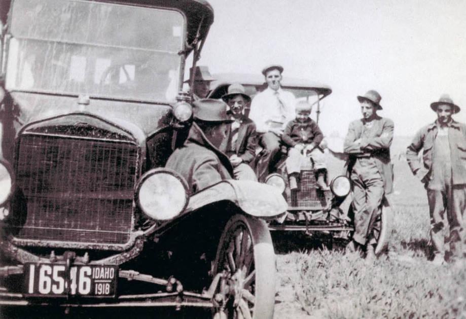 item thumbnail for Men Sitting on Cars