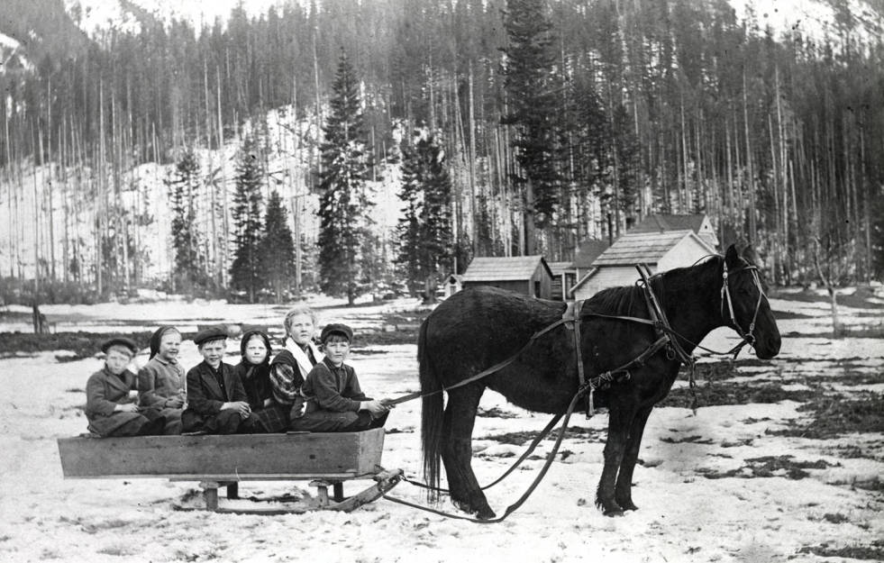 item thumbnail for Six children in horse-drawn sled.