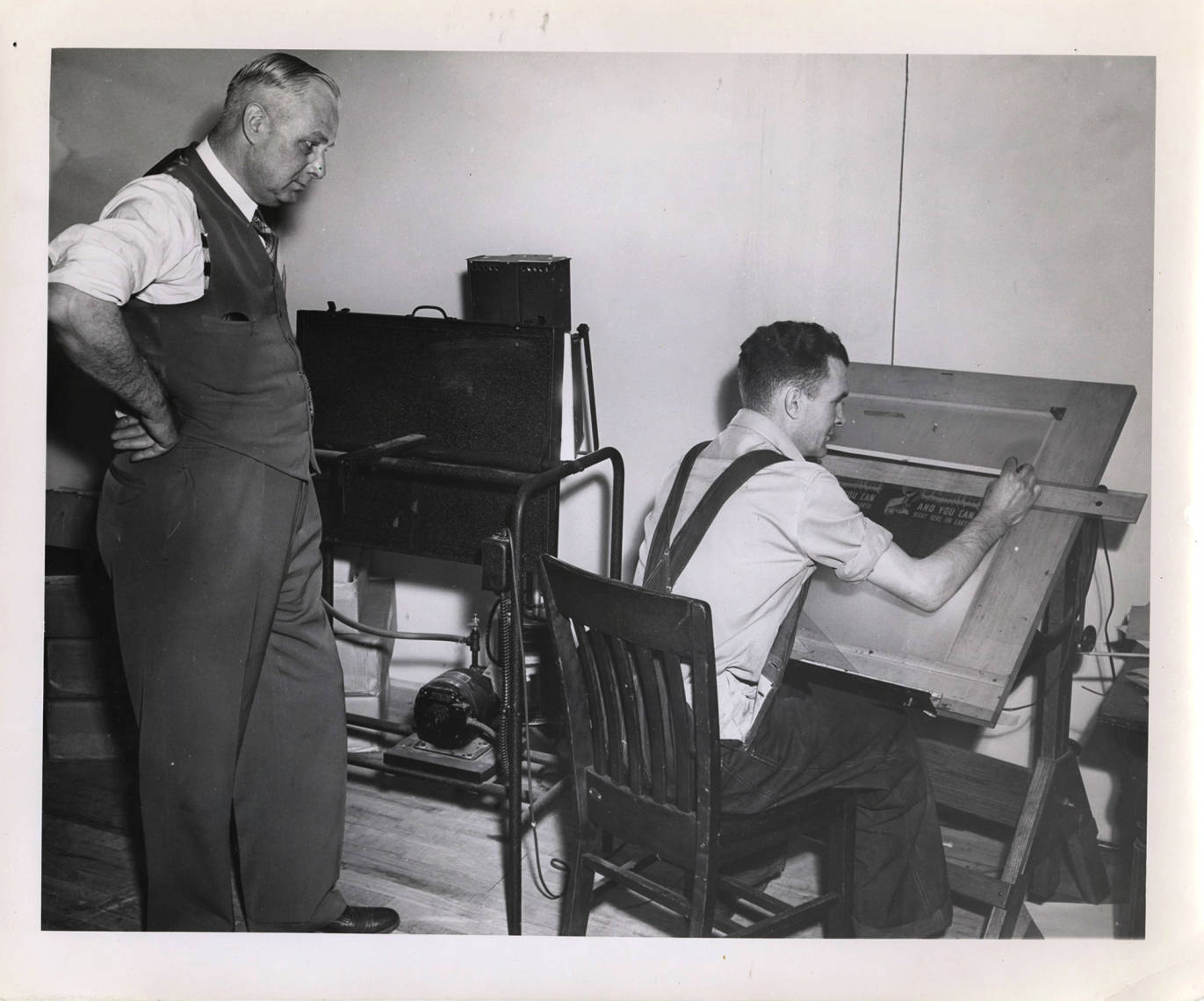item thumbnail for Photograph of Frank B. Robinson watching the work of an unidentified male staff member