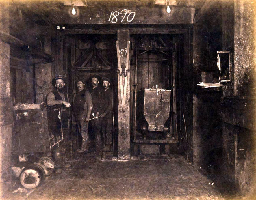 """item thumbnail for Mountain Consolidated Mine 100 ft. level Station (note """"1890"""" on beam) [no. 1212]"""